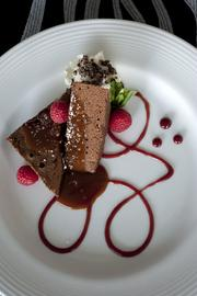 Flourless chocolate torte with cocoa nibs and raspberry coulis at Rivue.