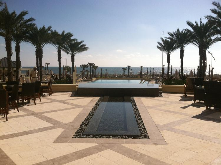 This is the view from the check-in area, which has two-story floor-to-ceiling windows to help guests immediately connect with the ocean.Click through the photos to see more of the resort.