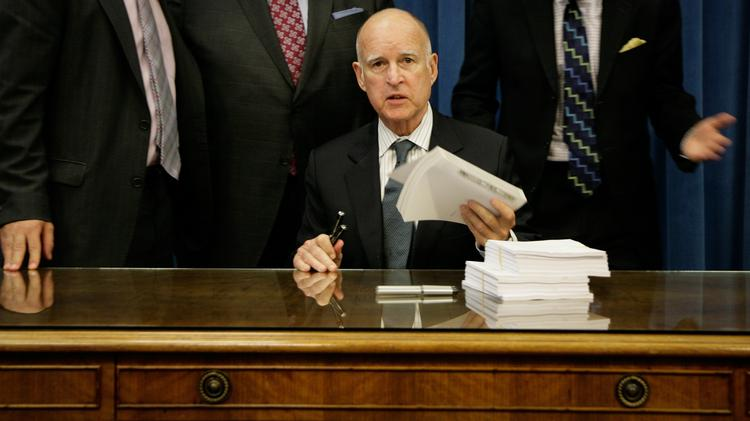 Gov. Jerry Brown, seen here earlier this year, signed legislation Monday that gives small employers the option to keep health care coverage that does not comply with the Affordable Care Act through 2015.