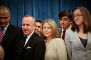 Gov. Jerry Brown signed two special session health care bills Thursday that will expand Medi-Cal coverage to an estimated 1.4 million Californians under provisions of the Affordable Care Act. Among those looking over Brown's shoulder are Sen. Pro Tem Darrell Steinberg and Health and Human Services Secretary Diana Dooley.