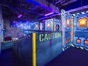 A shot inside the gaming area of Main Event Entertainment, which includes a laser tag arena.