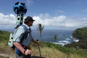 Rob Pacheco, owner and president of Hawaii Forest & Trail, wears the Google Street View Trekker at Polulu Valley Lookout on the Big Island of Hawaii.