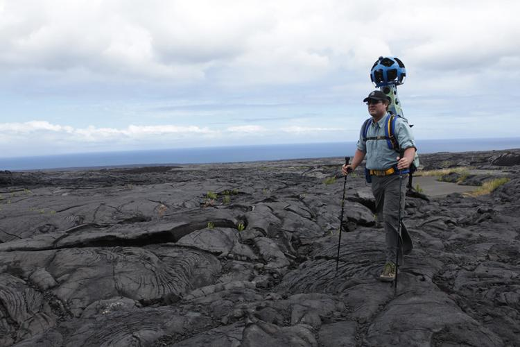 Rob Pacheco, owner and president of Hawaii Forest & Trail, is seen hiking thorugh Hawaii Volcanoes National Park wearing the Google Street View Trekker in this file photo. Google Maps has released new images of Hawaii beaches, trails and other sites taken with the Trekker.