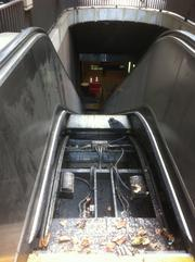 Escalators like this one at Embarcadero Station are exposed to the elements and need frequent repair.