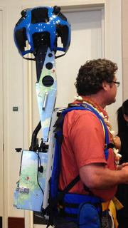 Rob Pacheco, owner and president of Hawaii Forest & Trail, models the Google Street View Trekker at a news conference with Google Maps and the Hawaii Visitors and Convention Bureau Thursday at the Hawaii Convention Center.