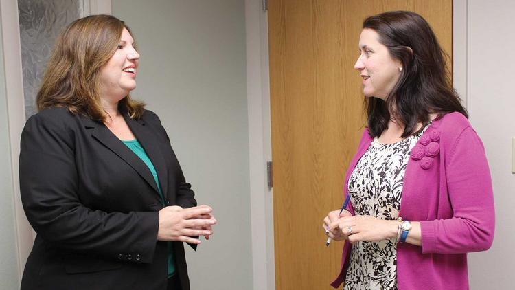 Julie Loesch, left, and Bridget O'Connell collaborate on mediation efforts for the Center for Resolution and Justice.