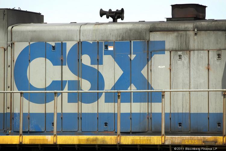 CSX Corp. signage is displayed on a locomotive in the company's railroad yard in Bedford Park, Illinois.
