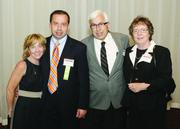 Fast Tracker Sam Mastovich of Keystone Compliance LLC is joined by his wife, Kerry, and his parents, George and Diana.