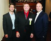 Fast Tracker Fred Hopke, center, of 4moms with co-workers Brian Grochal, left, and Rob Daiey.
