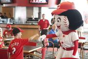 "Rosie Red visited with Reds fans who attended the ""Vote Reds"" lunch on Thursday, June 27 at the Champions Club at Great American Ballpark. She gets a fist bump from  fan, Bailey Stout, 7."
