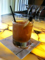 A Florida old fashioned, made with Kentucky bourbon, house-made peanut orgeat, Coca-Cola, finished with salted peanuts.