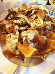 The signature blue cheese chips remain on the menu.