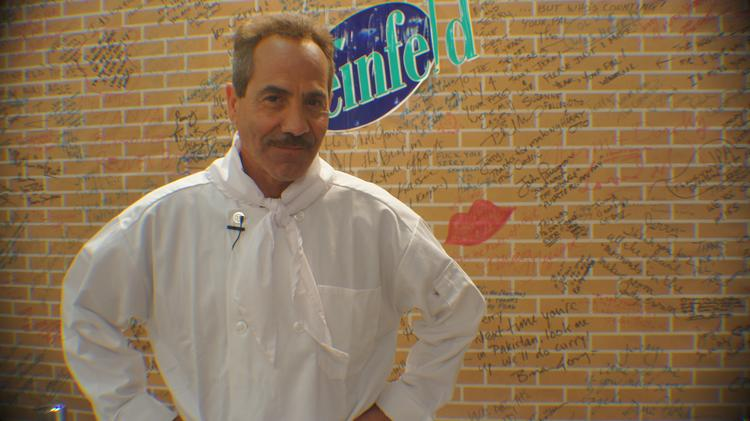 "Larry Thomas, the actor who played ""The Soup Nazi"" on ""Seinfeld,"" appears at a pop-up space that features a replica of Jerry Seinfeld's apartment and a museum exhibit associated with the show."