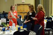 Business Development Executive Judy Gile, left, talks to attendees.