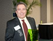 Tom Stapleton, senior vice president of Eagle Realty Group, accepts a winner's award for his company in the Green Building – for profit category.