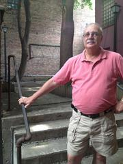 Jack Yonally stands near the hidden courtyard that will become an outdoor seating area behind Miranda's Deli at 52 Columbia St.
