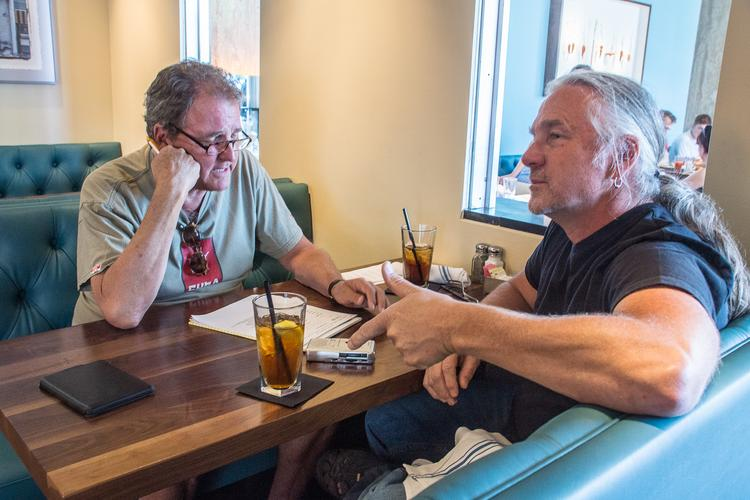 Bill Husted and Biker Jim Pittenger talk it over ... life and hot dogs.