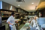 The open kitchen at Udi's is known for its pizzas and breads.