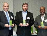 Accepting honorable mention awards in the Green Building category from left, are Hubert Co. President Bart Kohler, city of Hamilton's Deputy City Manager Tim Werdmann and former Director of Utilities for Cincinnati Public Schools Michael Burson. Potterhill Homes, which also received an honorable mention in the category, was not in attendance.