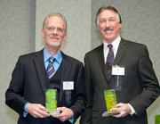 Accepting honorable mention awards in the Green Practice category, from left, are Rick Montgomery, facility/security manager for United States Playing Card Co., and Bill Gross, senior director of building services and zero waste ambassador for Luxottica.