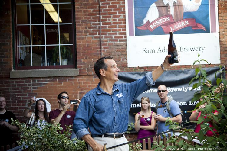 Jim Koch toasted to Brewlywed Ale and marriage, ceremoniously opening the bottle with a saber.