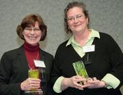 Accepting honorable mention awards in the Green Advocacy category are, from left, Mary Beth McGrew, associate vice president of planning, design and construction for the University of Cincinnati, and Ann Dougherty, sustainability coordinator for Xavier University.