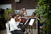 A string quartet played wedding music to entertain attendees and set the mood for the weddings.