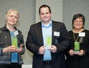 Accepting honorable mention awards in the Green Product/Service category are, from left, Deborah Jordan, board member of Enright Ridge Urban Eco-Village, Robert Broughton, Southeast regional manager of Steinert US, and Elizabeth Tu Hoffman, president and owner of Willow Ridge Plastics.