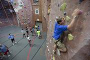 Jacob Brewer scales the wall at Adventure Rock   Click here to read story Rock climbing business ready to take next step