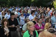 A large crowd watches the ribbon-cutting ceremony.