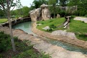 One of the new exhibit areas has a large pond.