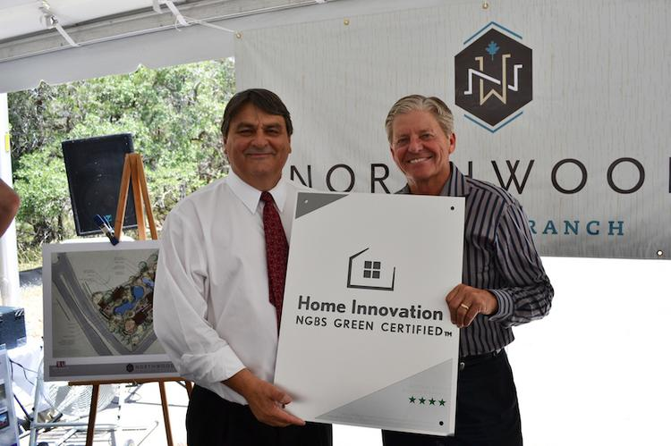 Michael Luzier, the president and CEO of Home Innovation Research Labs, presents Gary Newman, president of Trio Development LLC, the first four-star ICC 700 National Green Building Standard in Texas for the Northwoods at Avery Ranch development.
