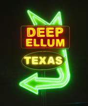 A large neon sign on Good-Latimer Expressway welcomes you to Deep Ellum.