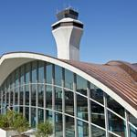Local officials want their free airport parking back