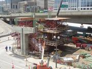 A stair tower has been poured for the Pete Rose Way pedestrian bridge, and the roof of the tower is now visible.