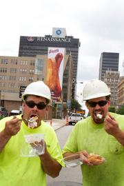 Jason Wallette, left, and Pete Conley of Danbert Construction got their hands on the restaurant's famous cream puffs during a break working nearby.
