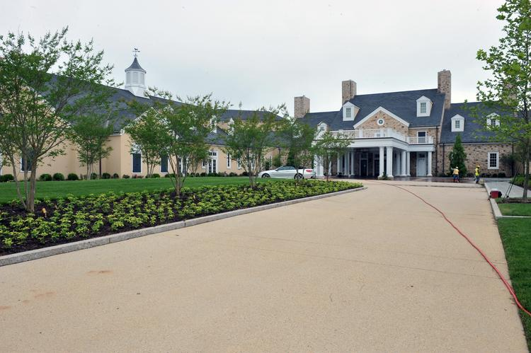 The entryway to the Salamander Resort in Middleburg, which will open Aug. 29 after several years of delays. About 150 London Planetrees line the winding driveway, and the fieldstone of the main building matches that on founder Sheila Johnson's Middleburg estate.