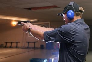Diederik van Hoogstraten test-fires a Smith & Wesson M&P .40-caliber handgun at the Smith & Wesson Academy in Springfield, Massachusetts. The New York City teachers pension fund recently decided to divest itself of gun manufacturer holdings, including Smith & Wesson.