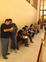 Some couples hastily complete forms outside the clerk's office at San Francisco city hall, not wanting to wait another day on June 28, when gay marriages resumed in California.