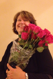 Joanie Juiter raced to San Fransisco city hall after gay marriages resumed June 28 to hand roses to couples exiting the clerk's office on their way to get married.