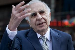 Carl Icahn, billionaire investor and chairman of Icahn Enterprises Holdings LP, talks outside of the Nasdaq MarketSite in New York.