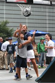 Xavier women's basketball coach Amy Waugh plays basketball on Fountain Square.