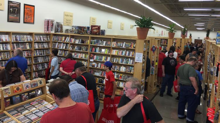 Customers browse Half Price Books' Irving store.