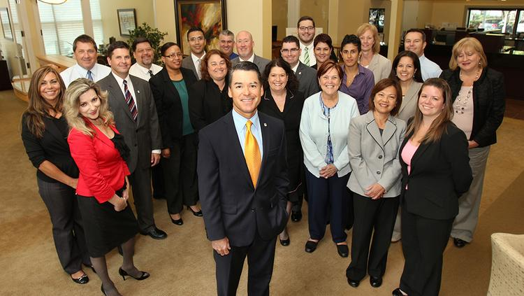 At First Citrus Bank headquarters in Tampa, Jack Barrett, president and CEO (front and center) gathers with some of his expanded bank staff in the bank headquarters.