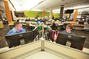 From left, Jason Bohn and Arthur Bollis work at Corvisa Cloud LLC, housed in Corvisa Services' 18,000-square-foot office at 1610 N. Second St. in Milwaukee.