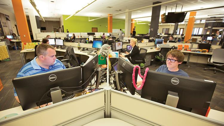 From left, Jason Bohn and Arthur Bollis work at CorvisaCloud LLC, housed in Corvisa Services' 18,000-square-foot office at 1610 N. Second St. in Milwaukee.