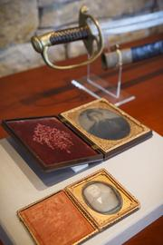 Top, the rare 1833 Republic of Texas officer's cutlass, and two portraits of iconic Texas hero Sam Houston, including one believed to be created in a Houston studio in June 1863, only a few weeks before his death.