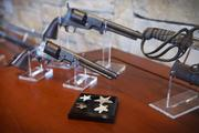 Among John Nau's Civil War collection are a pair of Colt .45 pistols, left, and a rare 1833 Republic of Texas officer's sword, right, used in the Civil War by Texas cavalry officer Col. William Amos Wortham. In foreground is a collection of Texas Star uniform and cap badges.