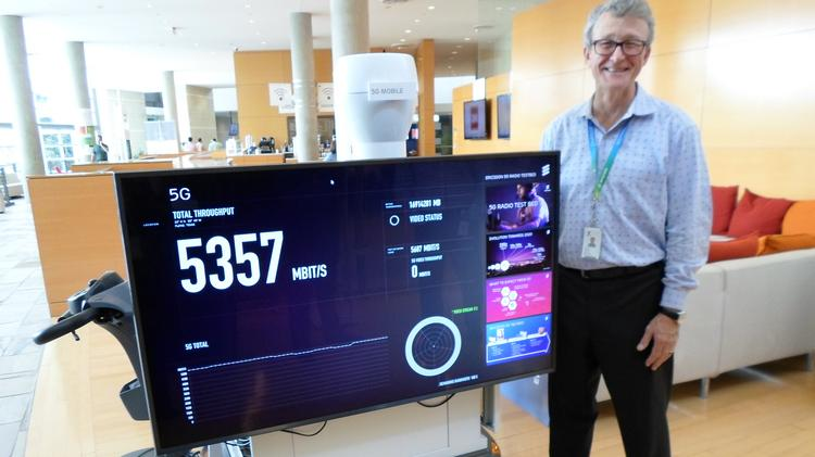 Keith Shank, Ericsson's Experience Center director, stands next to his first 5G mobile unit, which was reporting speeds of 5357 megabits per second.