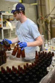 Erik Johnsen, a packaging line employee and brewer in training.